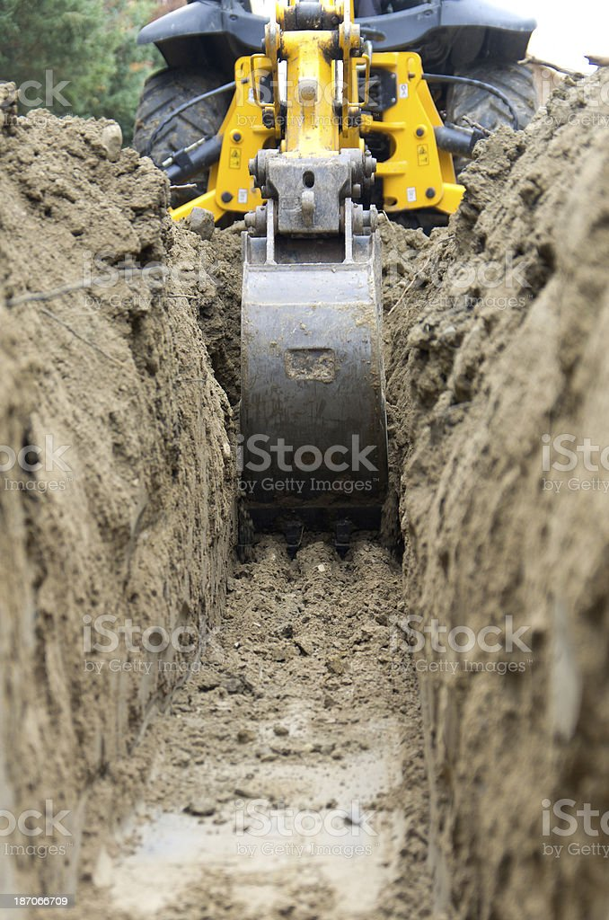 Backhoe Digging a Trench stock photo