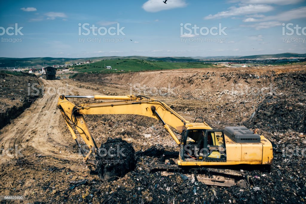 backhoe excavator machinery digging and working on construction site stock photo