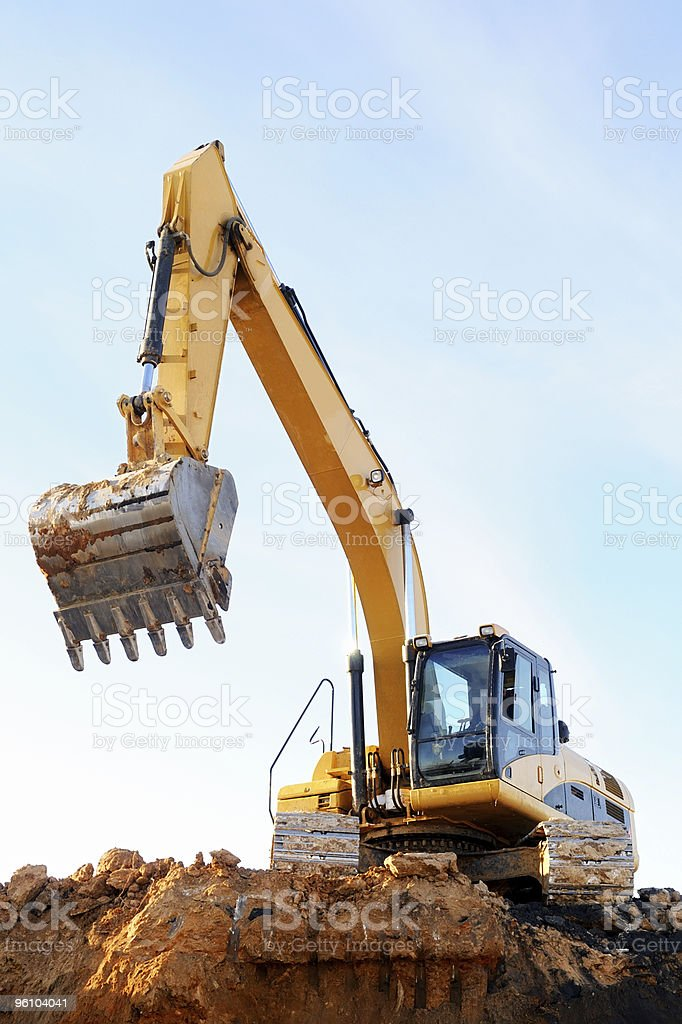 Backhoe loader digger excavating earth stock photo