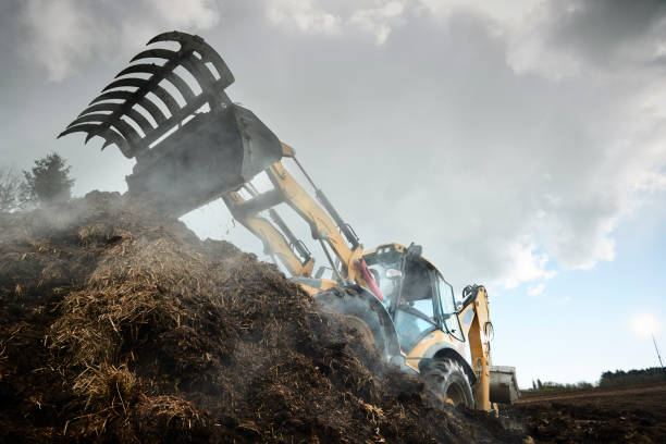 Backhoe loader digging in the dirt stock photo