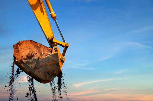 Excavator lifting dirt.