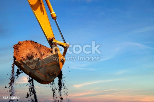 Excavator lifting dirt.