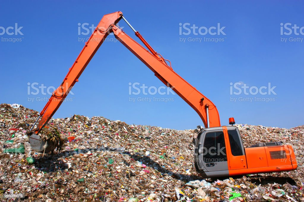 Backhoe working on garbage dump in landfill - Royalty-free Activity Stock Photo