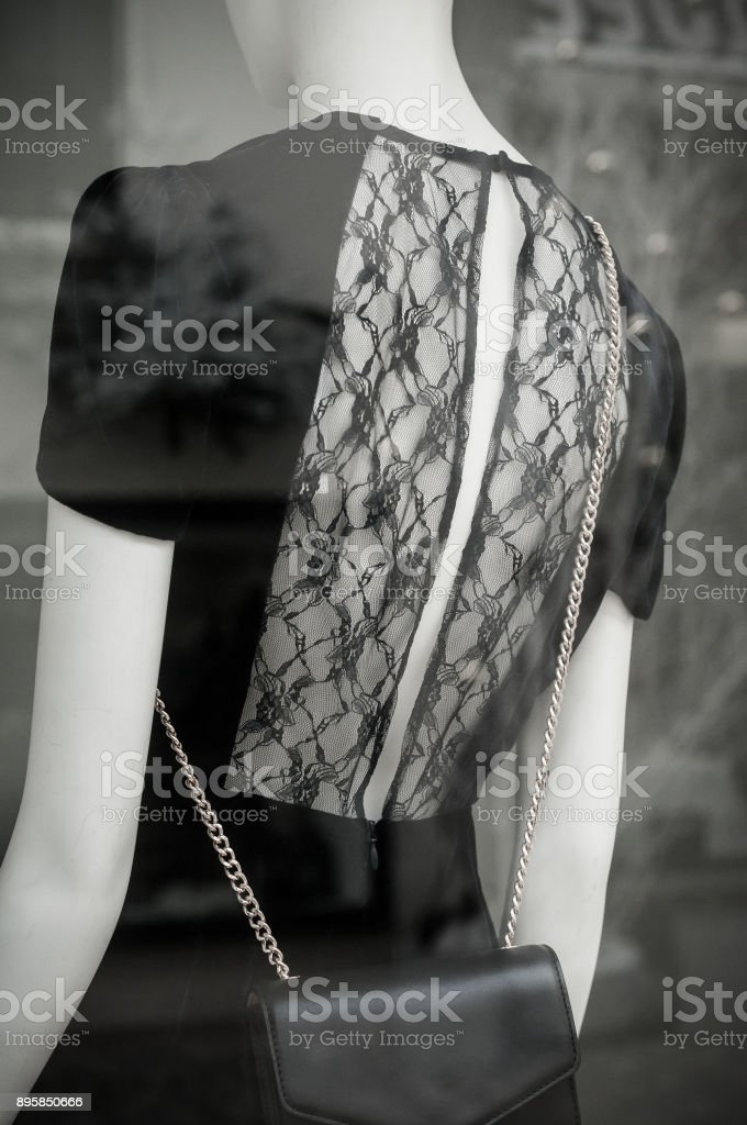 backless dress on mannequin in fashion store showroom stock photo