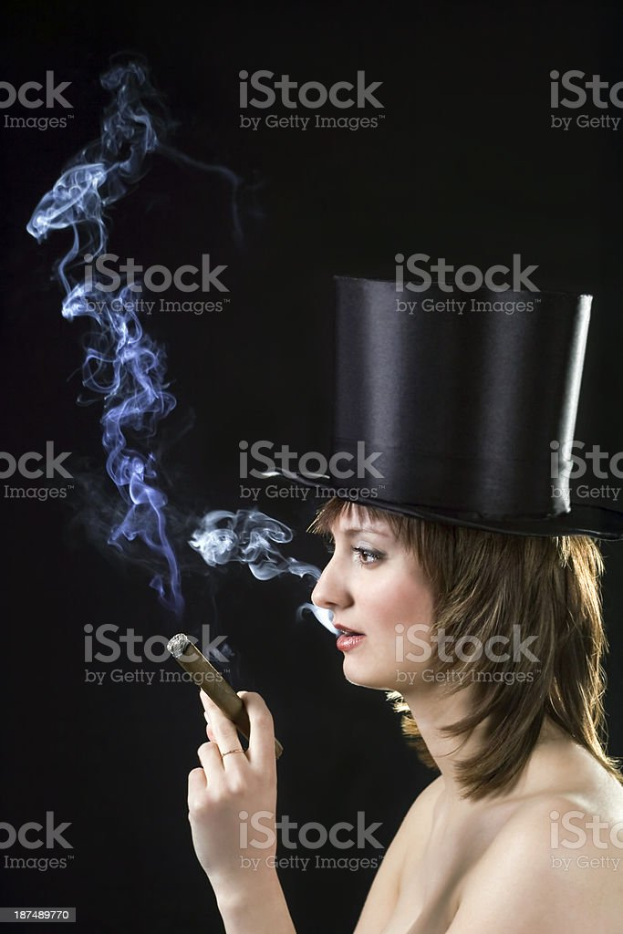 backlight picture of topless brunette smoking cigar royalty-free stock photo