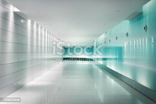 istock Back-lighted glass walls in an underground futuristic corridor 133830608