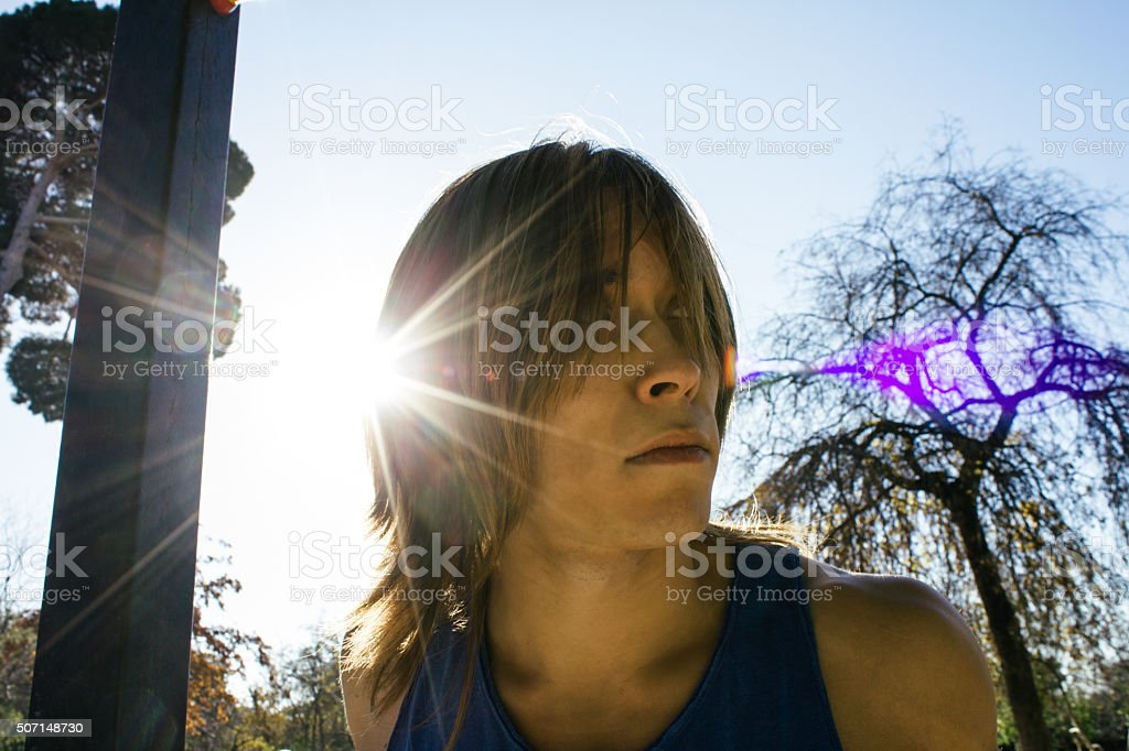 Backlighting of a man with long hair stock photo