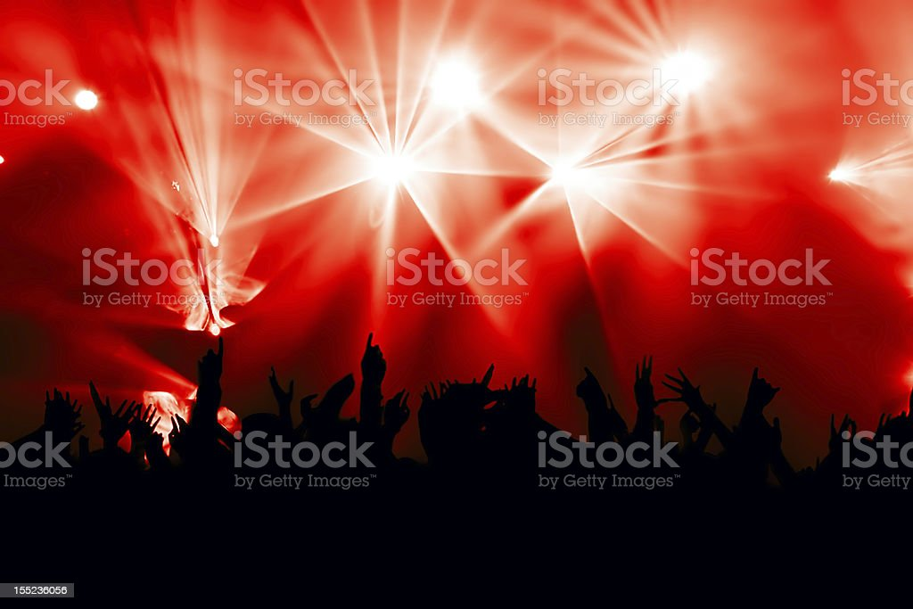 Backlit cheering crowd at concert red background royalty-free stock photo