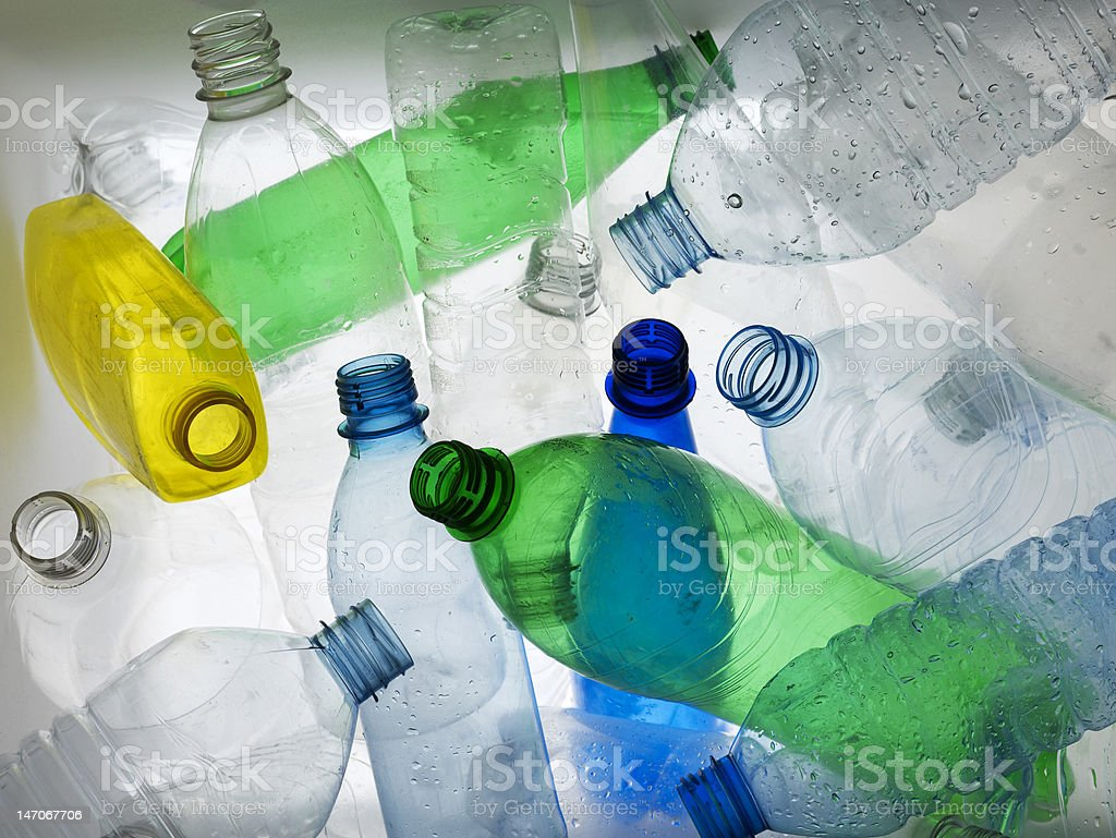 Backlit collection of colourful plastic bottles stock photo