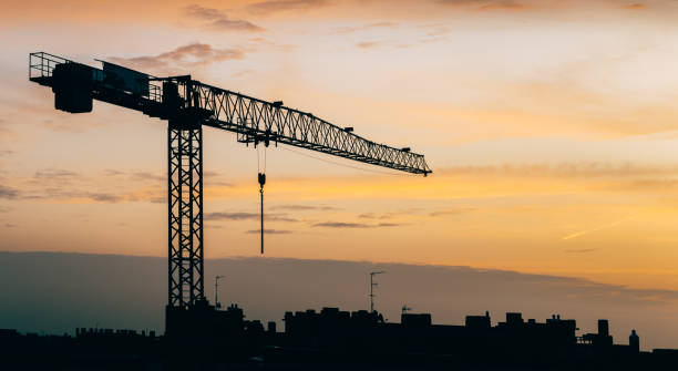Backlit construction crane at yard with copy space stock photo