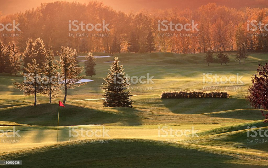 Backlit Golf Green in Pristine River Valley stock photo