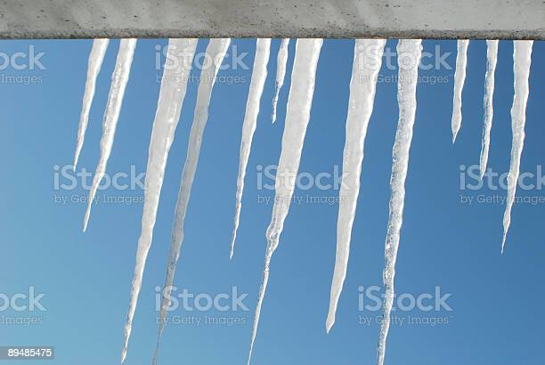 Photo of backlit icicles hanging out
