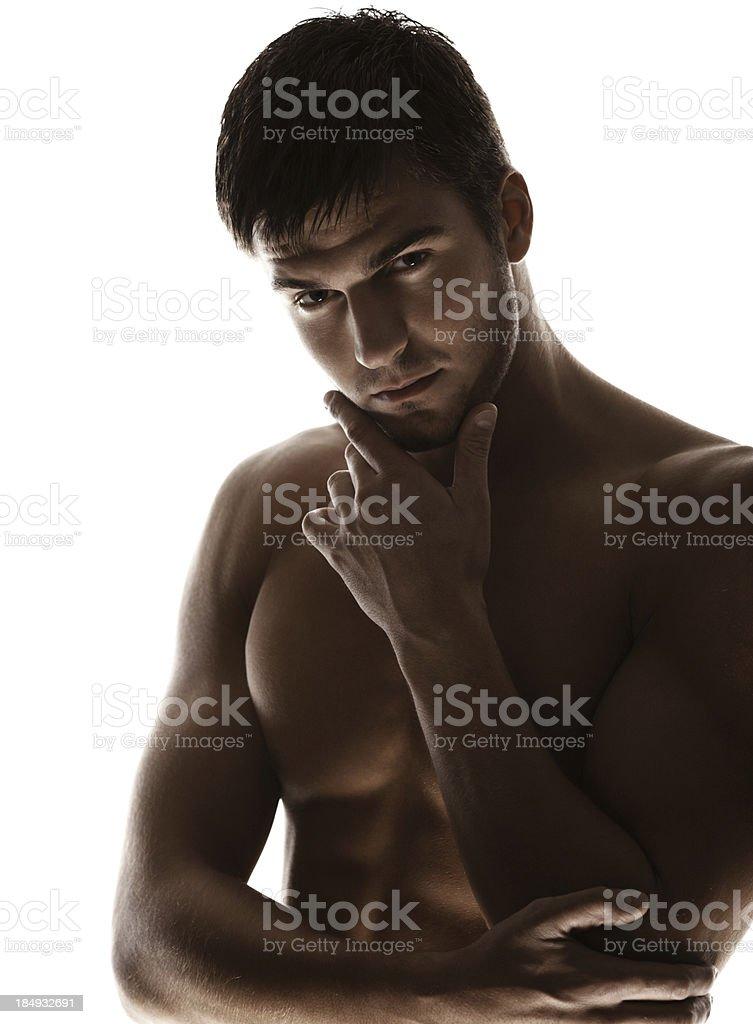 Backlit macho guy. stock photo