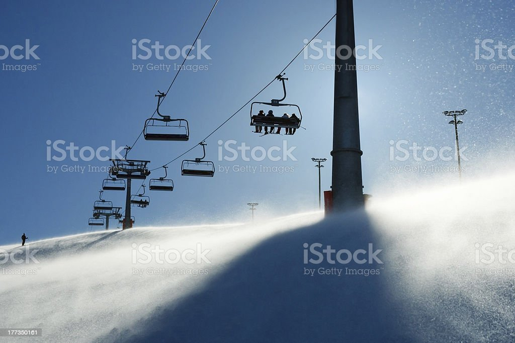 backlit scenes with ski lift chairs stock photo