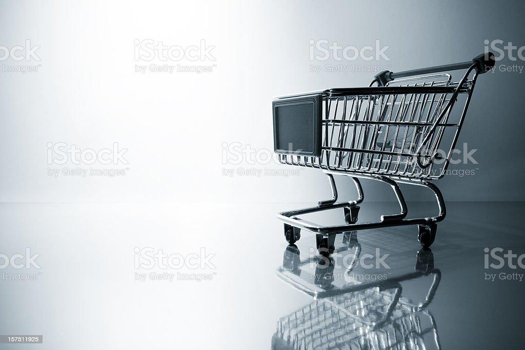Backlit shopping cart. Basket Business Retail e-commerce Shop Wagon Store royalty-free stock photo