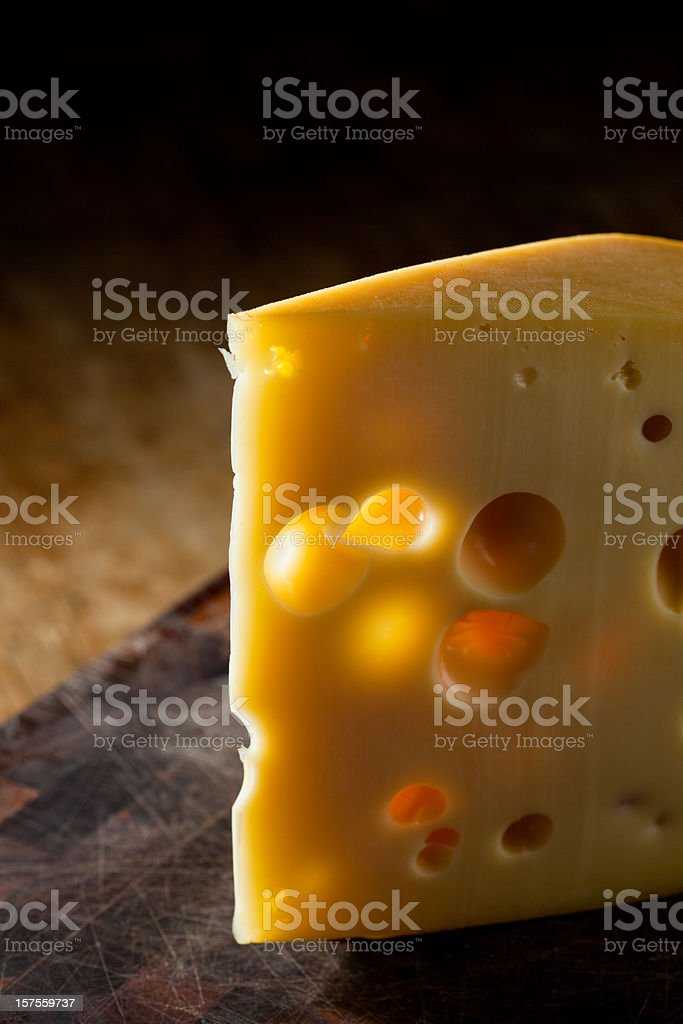 Backlit slice of cheese royalty-free stock photo