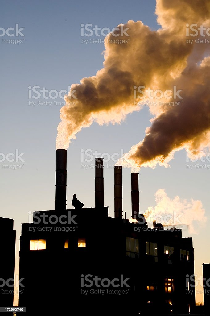 Backlit Steam Plant royalty-free stock photo