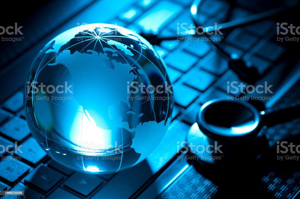 Backlit Stethoscope and globe stock photo