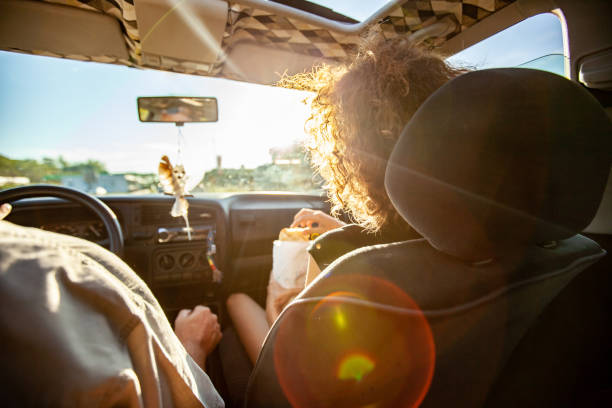 backlit sunset view from the rear car seat - vacations food stock pictures, royalty-free photos & images
