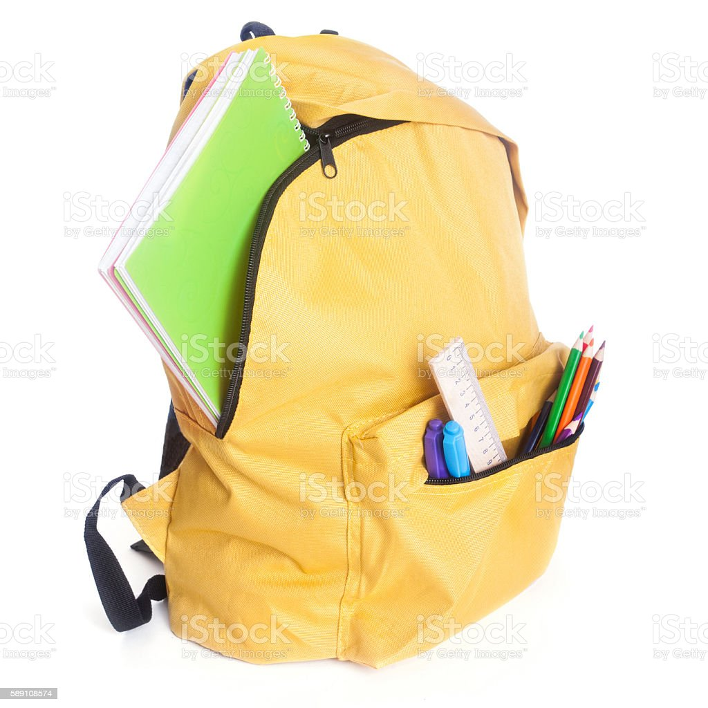 Backpack full of school supplies stock photo