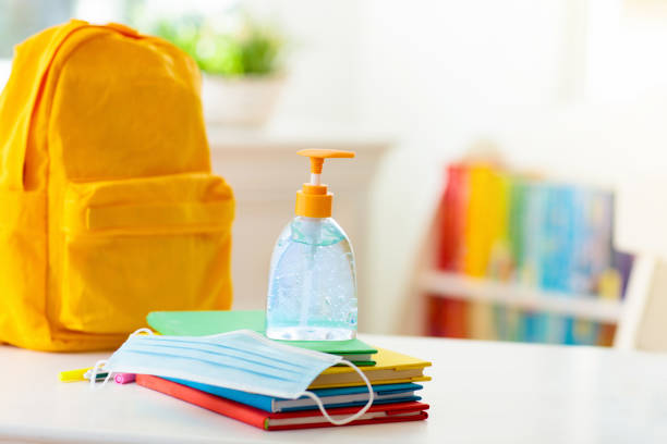 Backpack of school child. Face mask and sanitizer. Backpack of school child with face mask and sanitizer. Student safety after coronavirus pandemic. Virus and disease prevention for kids. Back to school and kindergarten after covid-19 outbreak. back to school stock pictures, royalty-free photos & images