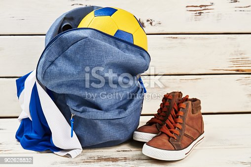 istock Backpack, sneakers, ball and uniform 902628832