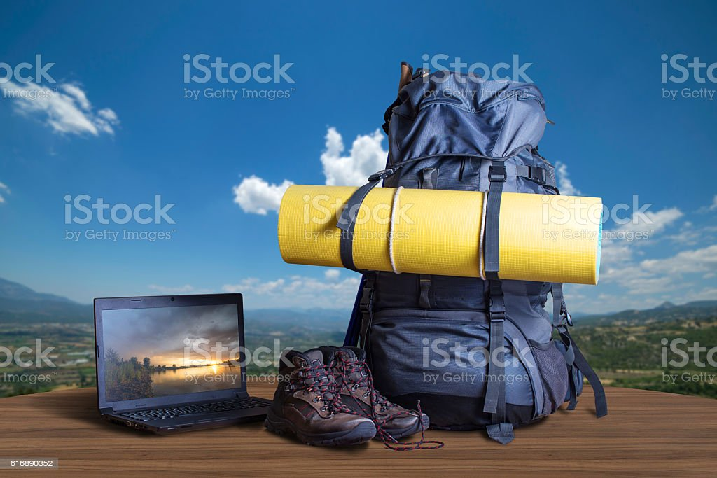 Backpack, trekking shoes, notebook, traveler equipment stock photo