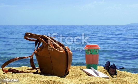 Objects on sandy beach by the sea