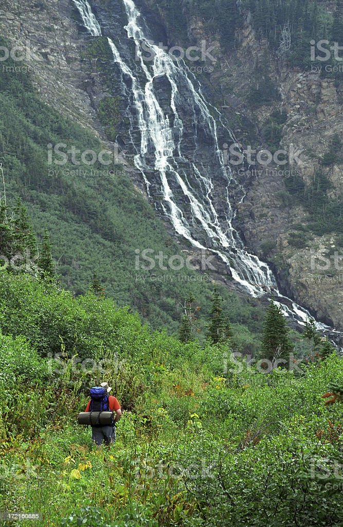 Backpacker and Waterfall royalty-free stock photo
