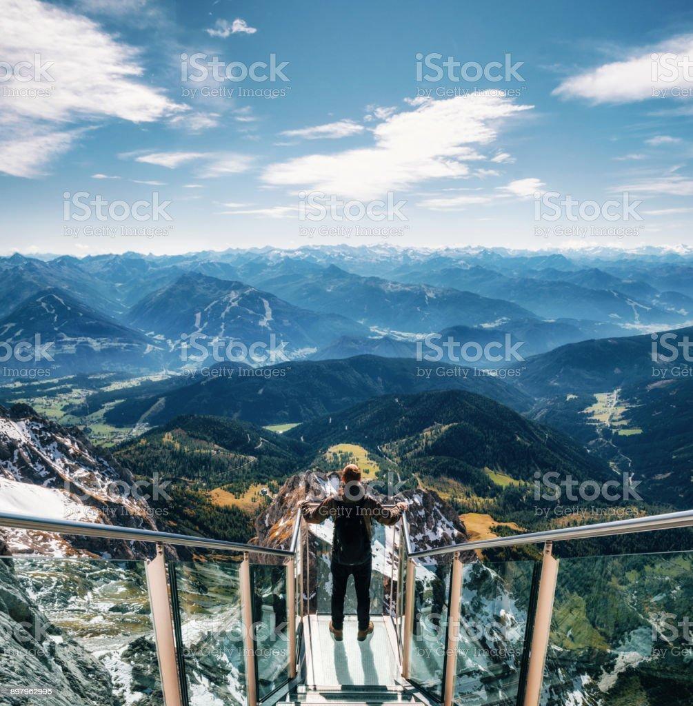 Backpacker at skywalk bridge in Dachstein, Austria stock photo
