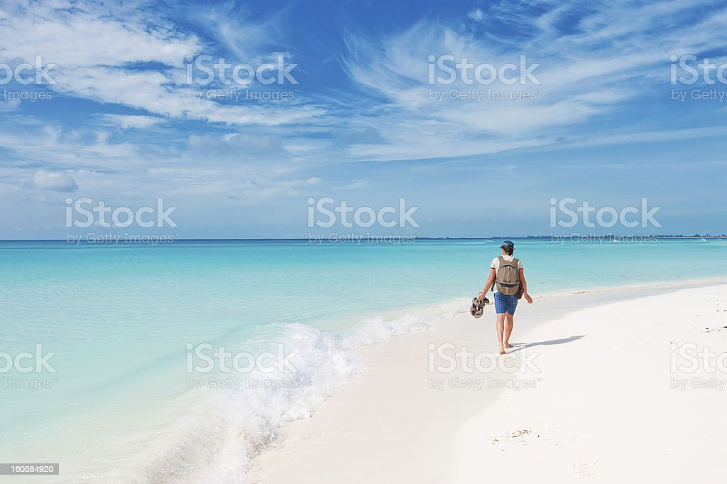 Backpacker by the sea royalty-free stock photo