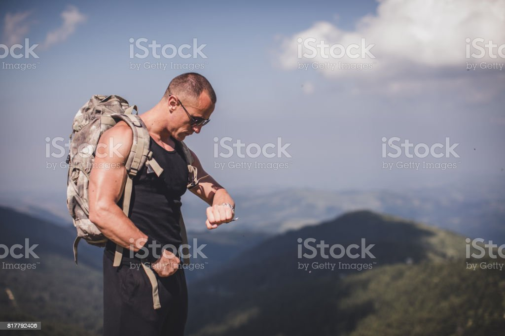 Backpacker checking the time stock photo