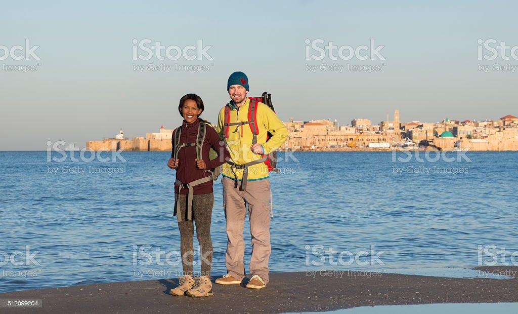 Backpacker couple traveling in Akko city. stock photo