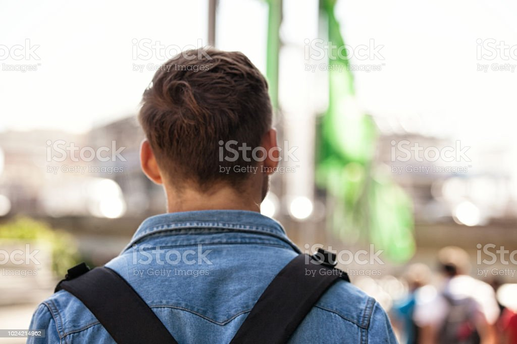 backpacker from behind stock photo