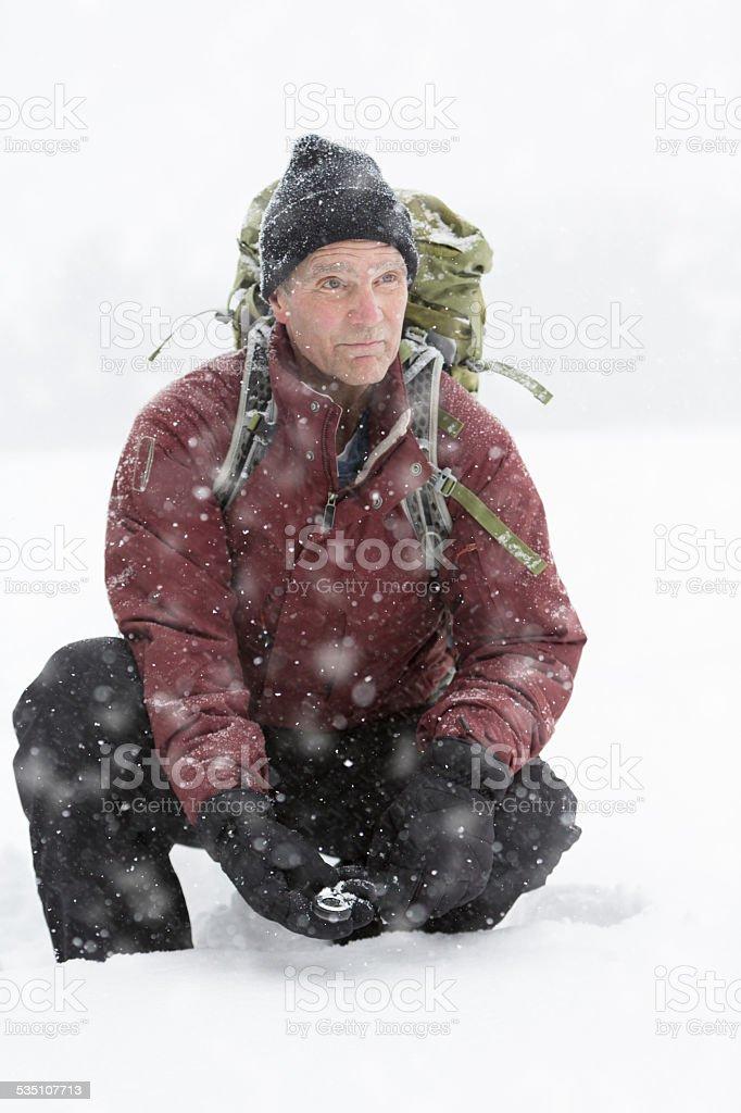 Backpacker Getting his Bearings stock photo
