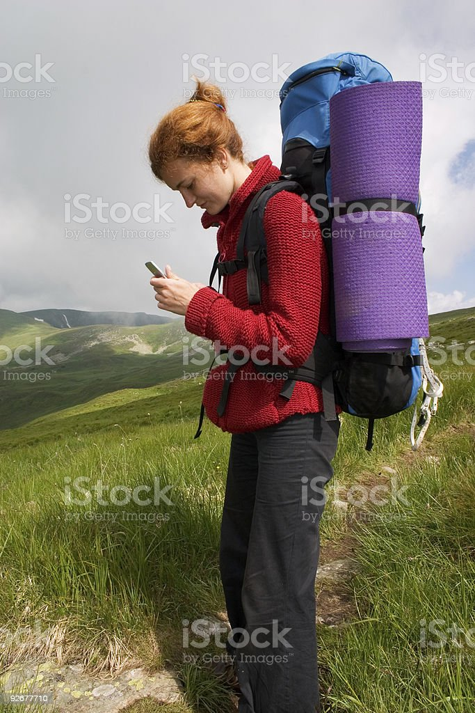 Backpacker girl with phone royalty-free stock photo