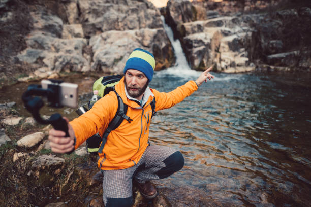 backpacker hiking and vlogging - vlogger stock photos and pictures