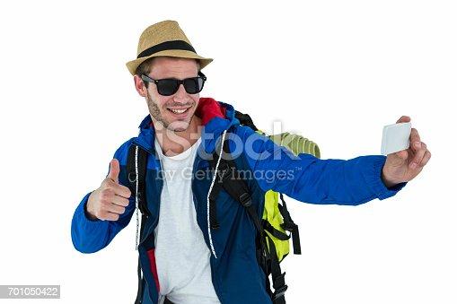 istock Backpacker hipster taking a selfie 701050422