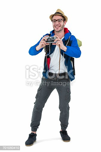 istock Backpacker hipster taking pictures with a retro camera 701050410