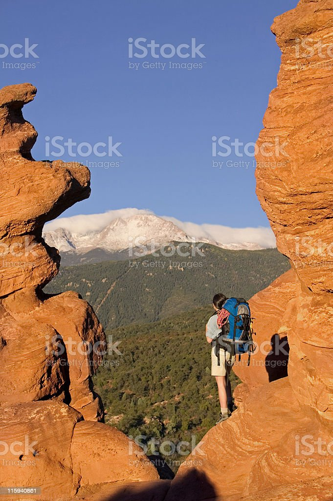 Backpacker Looking at Rocky Mountain View royalty-free stock photo