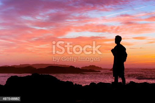 istock backpacker looking at sunset, silhouette, travel concept 497548882