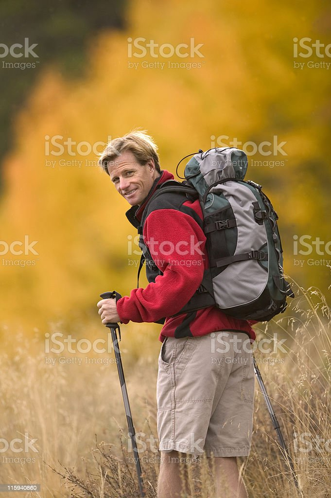 Backpacker Looking Back at Camera in Fall royalty-free stock photo
