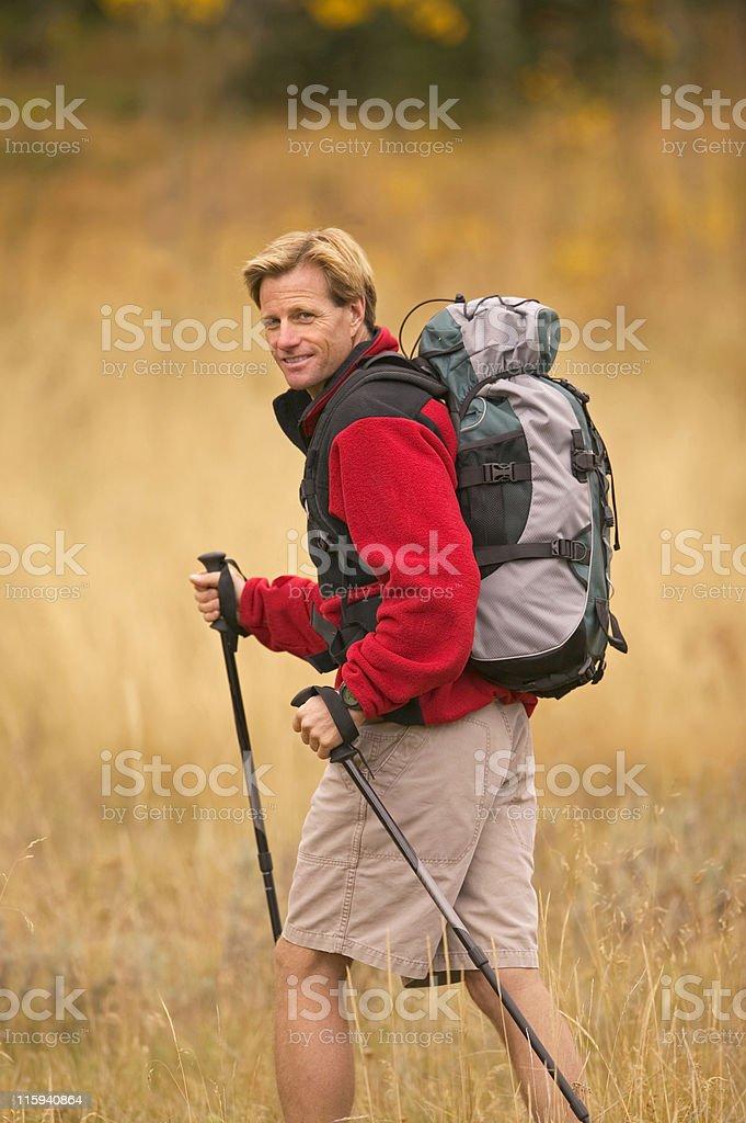 Backpacker Looking Back at Camera royalty-free stock photo
