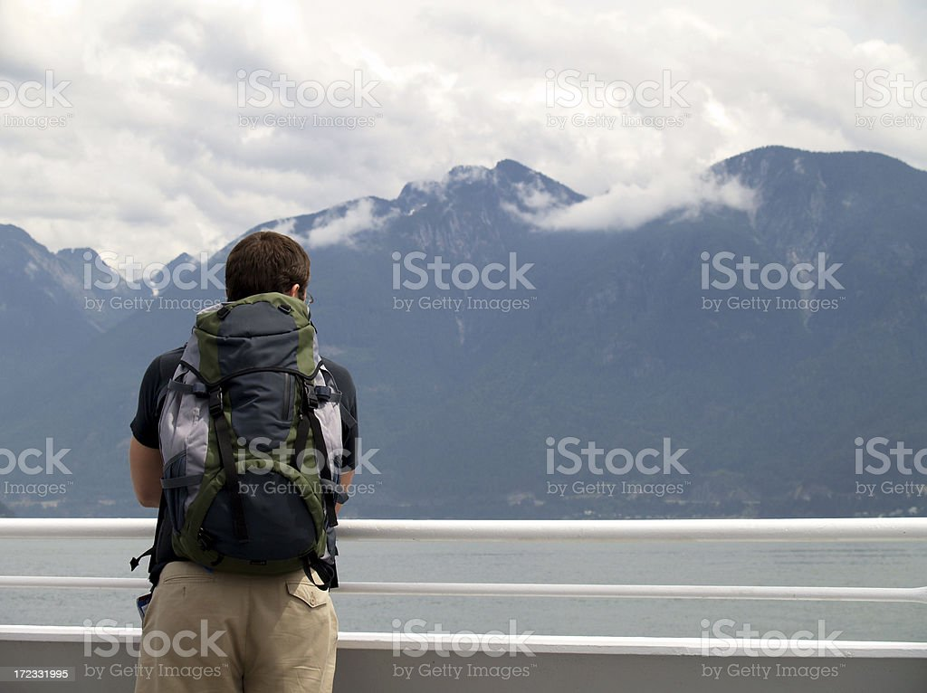 Backpacker on a ferry journey stock photo