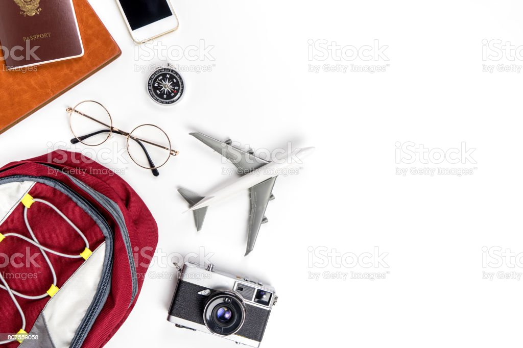 Backpacker travel accessories on white copy space stock photo