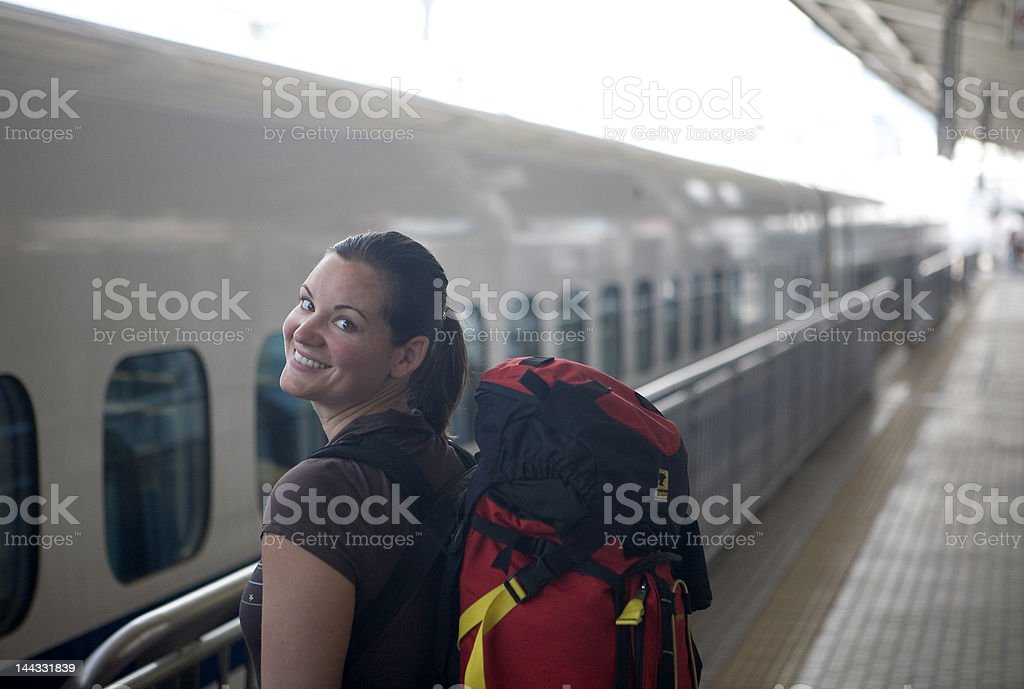 Backpacker waiting for train royalty-free stock photo