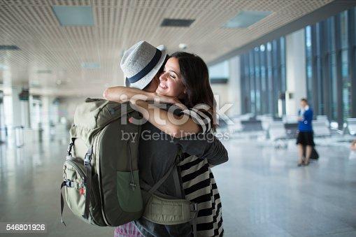 istock Backpacker welcome hug in the airport. 546801926