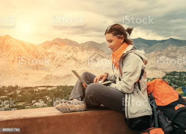 Backpacker with laptop sits on the top view point under mountain picture id655931794?b=1&k=6&m=655931794&s=612x612&h=lehswwvgc1aoeozlhzp4poapmn1mqeg0zvpqicg84ru=