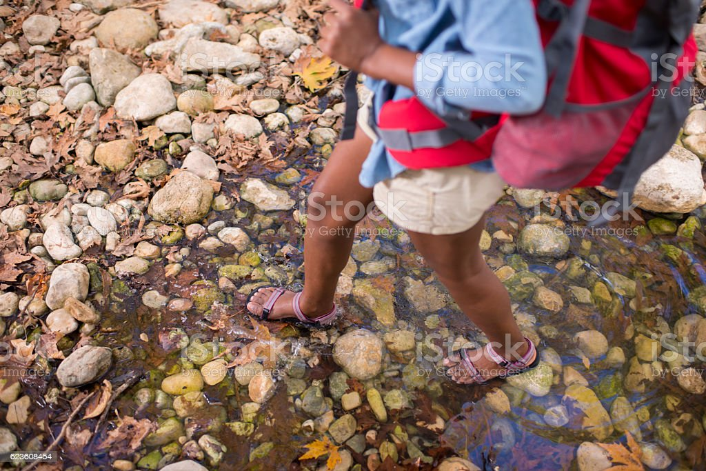Backpacker woman traveling outdoor. stock photo