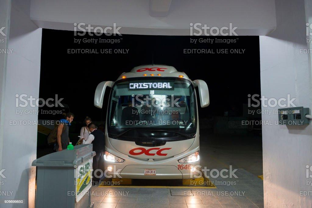 Backpackers boarding overnight bus in Pochutla, Mexico stock photo